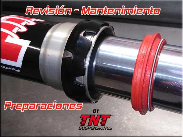 revisión mantenimiento horquilla amortiguador moto